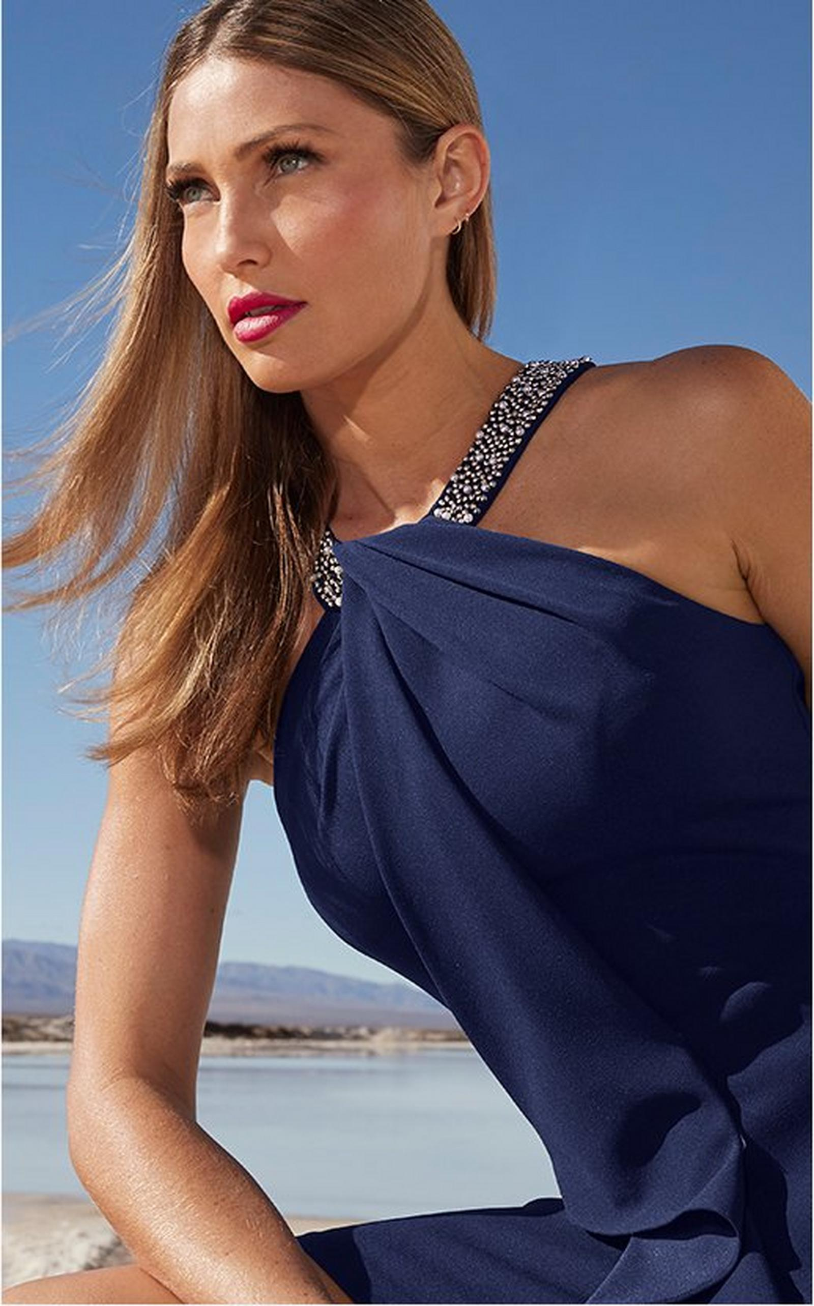 model wearing a blue dress with a sequin neckline.
