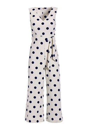 white and navy polka dot crop jumpsuit with a tie waist.