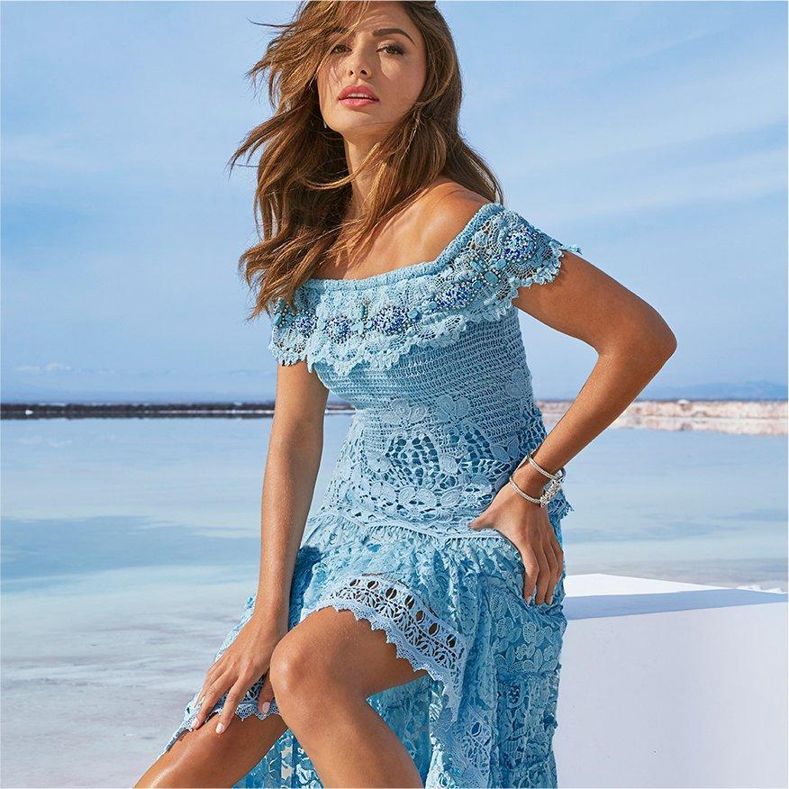 model wearing an off-the-shoulder light blue high-low maxi dress.
