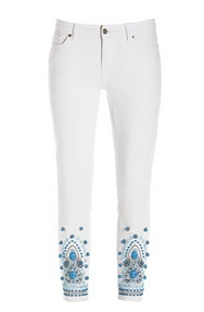 white jeans embellished with turquoise baubles.