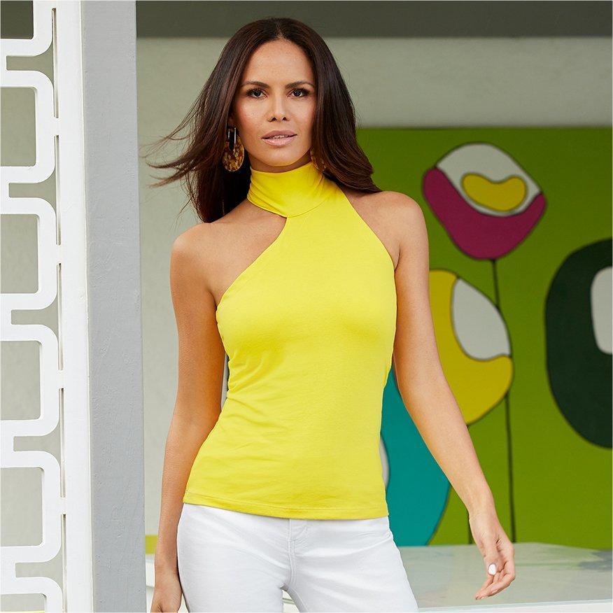 model wearing a yellow sleeveless asymmetrical choker top and white pants.