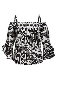 black and white printed cold-shoulder top with floral applique embellishments.