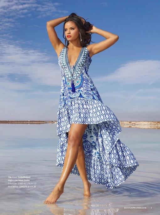 model wearing a blue tile print embellished high-low maxi dress.