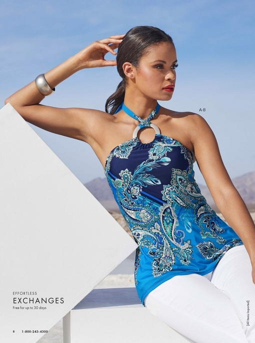 model wearing a blue ring detail paisley-print halter top and white jeans.