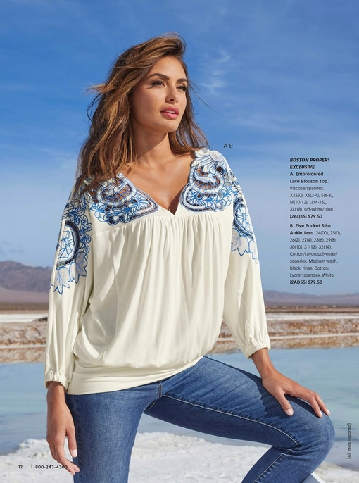 model wearing a blue and white embroidered lace blouson top and jeans.