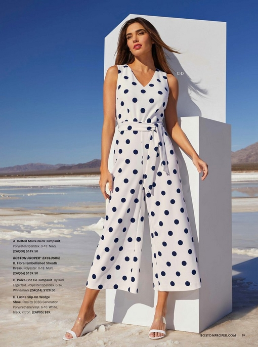 model wearing a black and white polka dot tie-waist crop jumpsuit and white wedges.