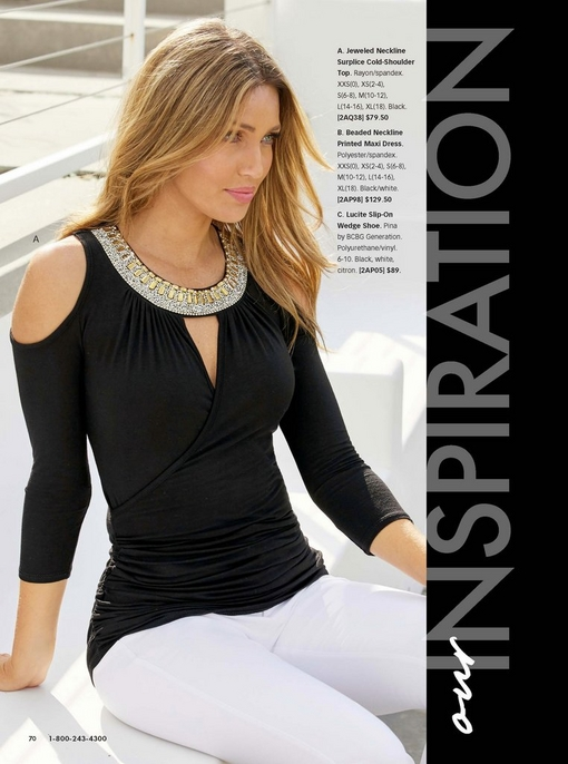 model wearing a jeweled neckline surplice cold-shoulder top in black with white jeans.