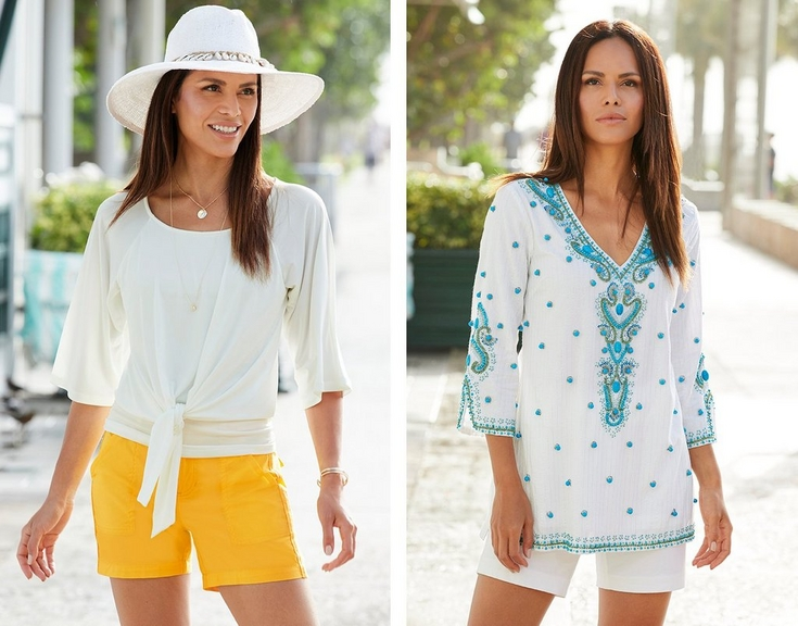 left model wearing a white scoop-neck tie-front shirt, yellow cargo shorts, and a white shell embellished hat. right model wearing a blue and white tunic top with bauble embellishments and white shorts.