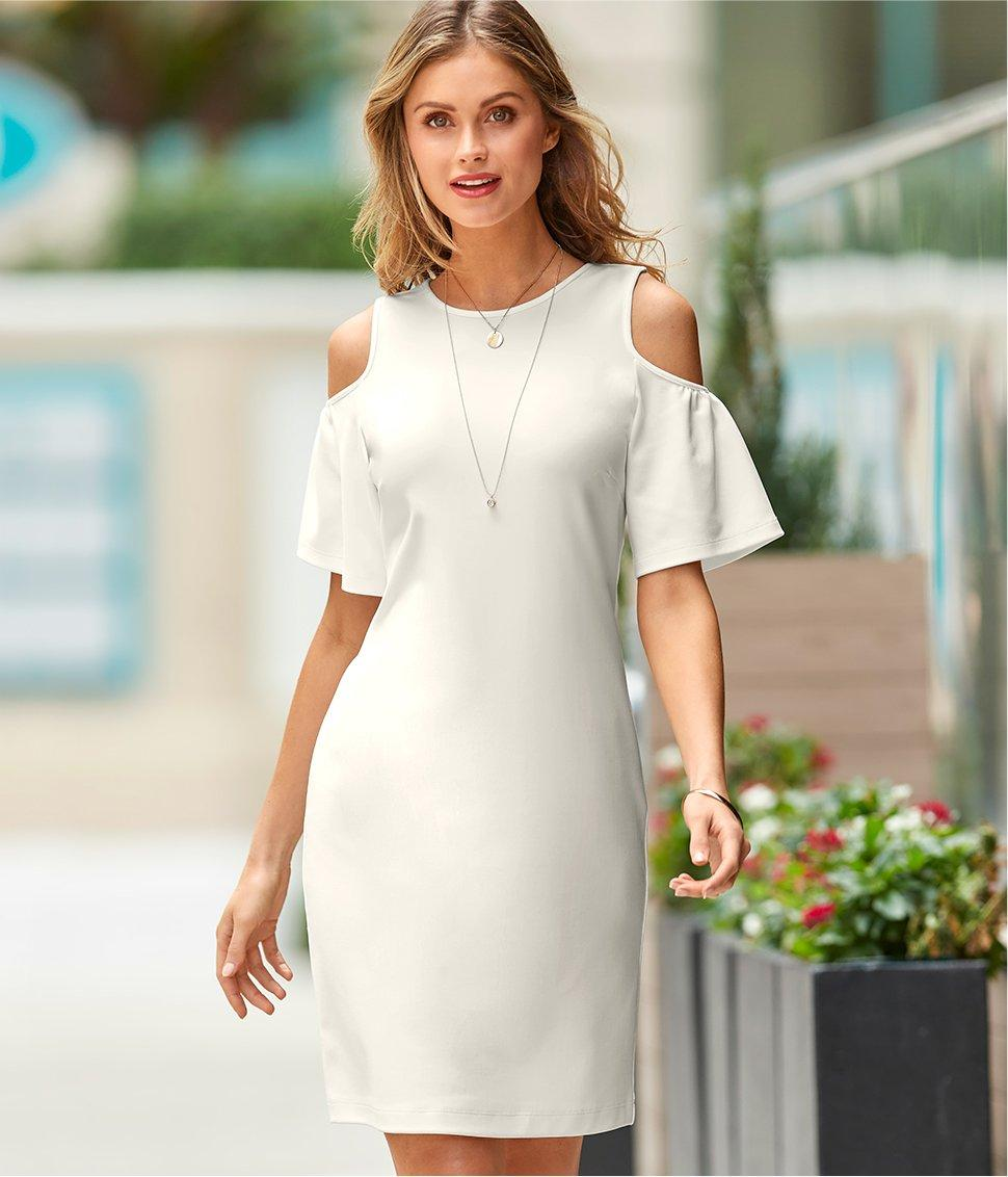 model wearing an off-white cod-shoulder flare-sleeve dress.