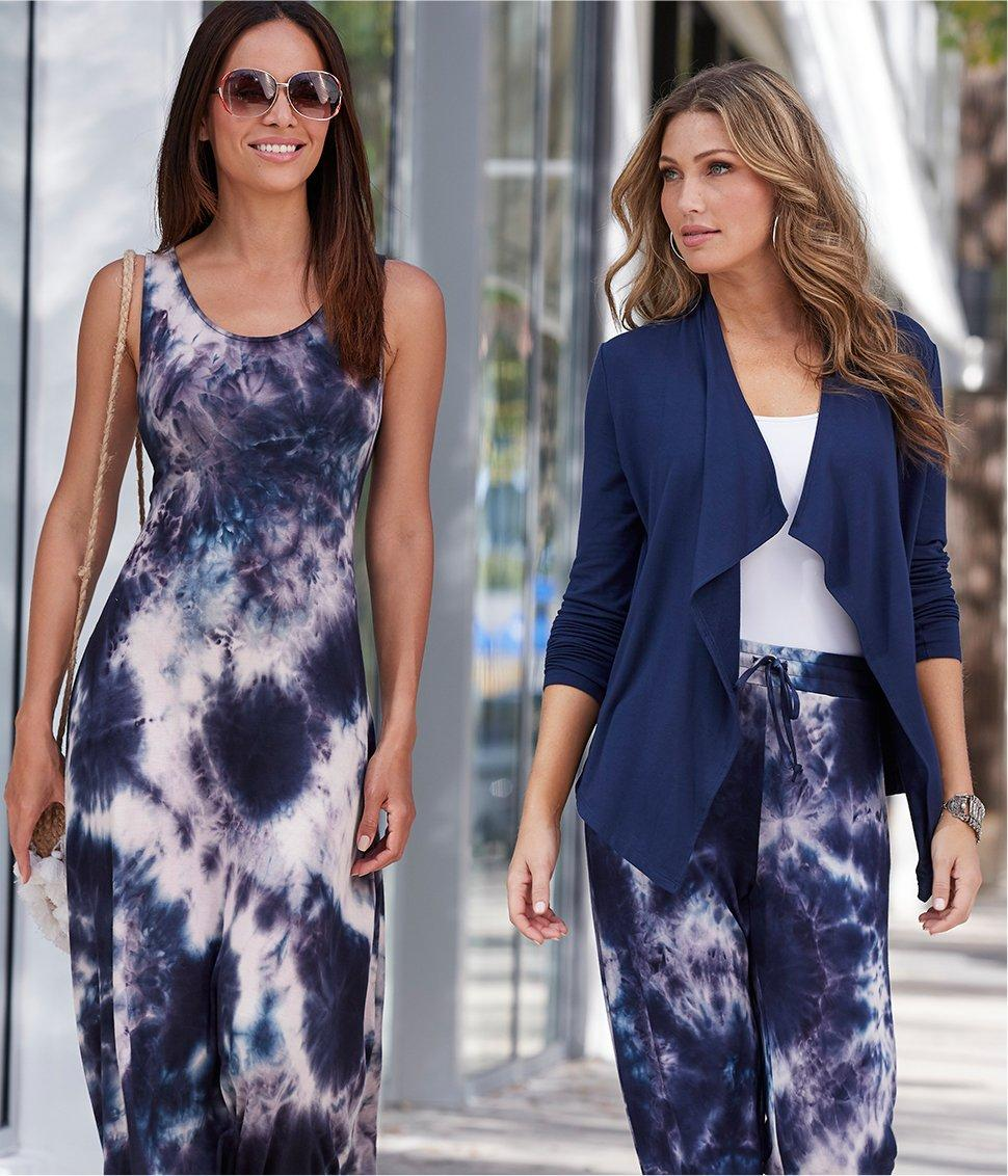 left model wearing a blue and white tie-dye maxi dress and sunglasses. right model wearing a navy cardigan, white tank top, and blue and white palazzo pants.