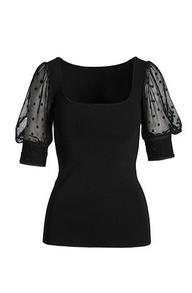 a black illusion puff-sleeve short sleeve top.