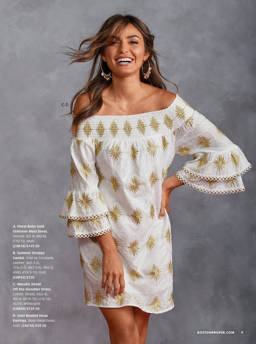 model wearing a white and gold off-the-shoulder tier sleeve dress and gold beaded hoop earrings