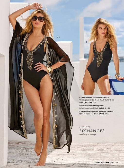 model wearing a black one-piece swimsuit with gold embellishments, sunglasses, and a black kimono cover up with gold embellishments.
