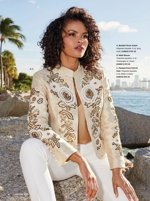 model wearing an off-white beaded floral jacket, tan v-neck tank top, and white pleated pants.