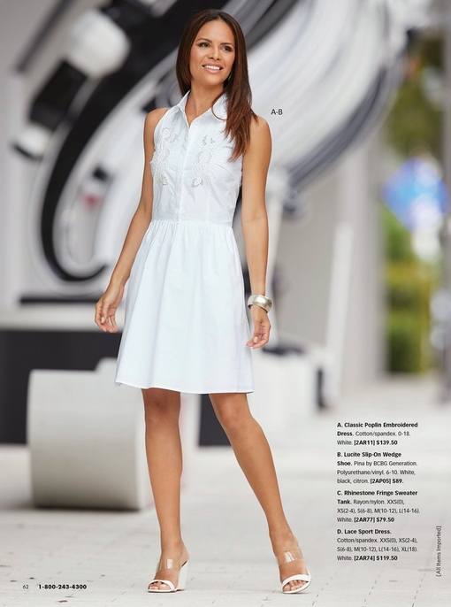 model wearing a white poplin embroidered dress and white wedges.