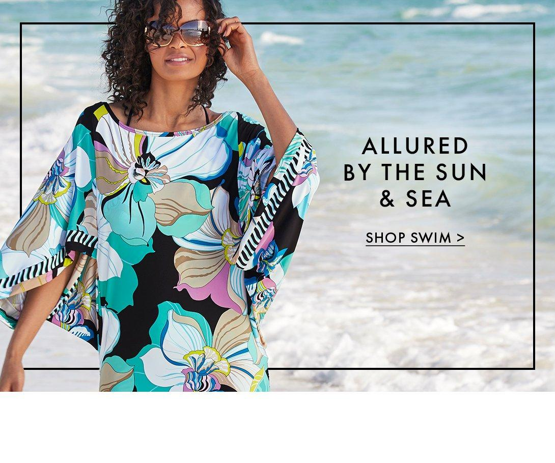 model wearing a floral printed cover-up and sunglasses.