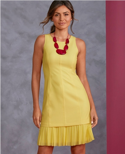 model wearing a ruffle hem sleeveless yellow dress and a red stone necklace.
