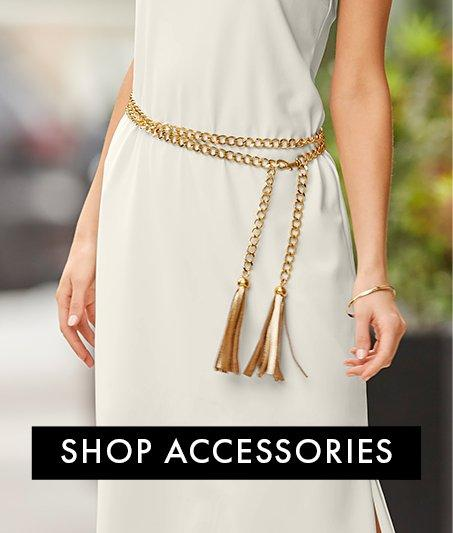 gold belt on an off-white maxi dress.