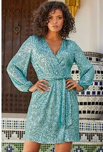 right model wearing a sequin long-sleeve blue dress with a tie-waist.
