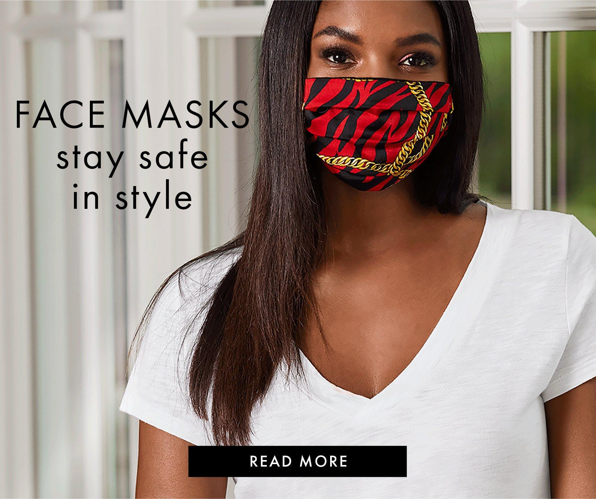 model wearing a red and black zebra stripe mask with gold chain design and a white tee-shirt.