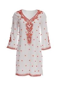 a white and orange bauble embellished tunic dress.