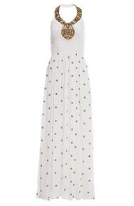 white maxi dress with a gold embellished halter neckline.