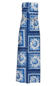 blue and white tile print strapless maxi dress with a gold belt.