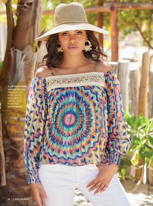 model wearing a multicolored long-sleeve cold-shoulder top with jewels lining the top, white pants, straw hat, and floral earrings.