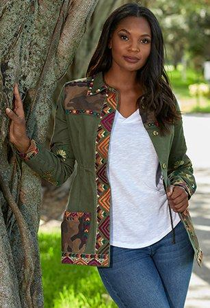 left model wearing an army green jacket with multicolored embroidery and a white t-shirt. right panel is white text on maroon background: fall preview. be first to shop the latest looks (and selling fast). shop leggings. shop jackets. shop tops & tunics.