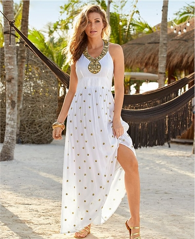 model wearing a white and gold halter maxi dress with a jewel embellished neckline.