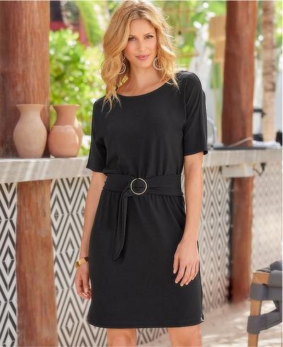 model wearing a black short sleeve belted sheath dress.