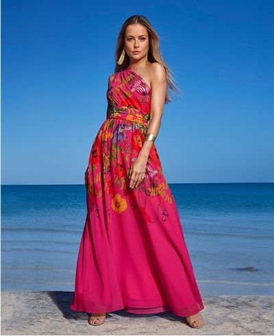 model wearing a one-shoulder pink floral printed gown with a cinched waist.