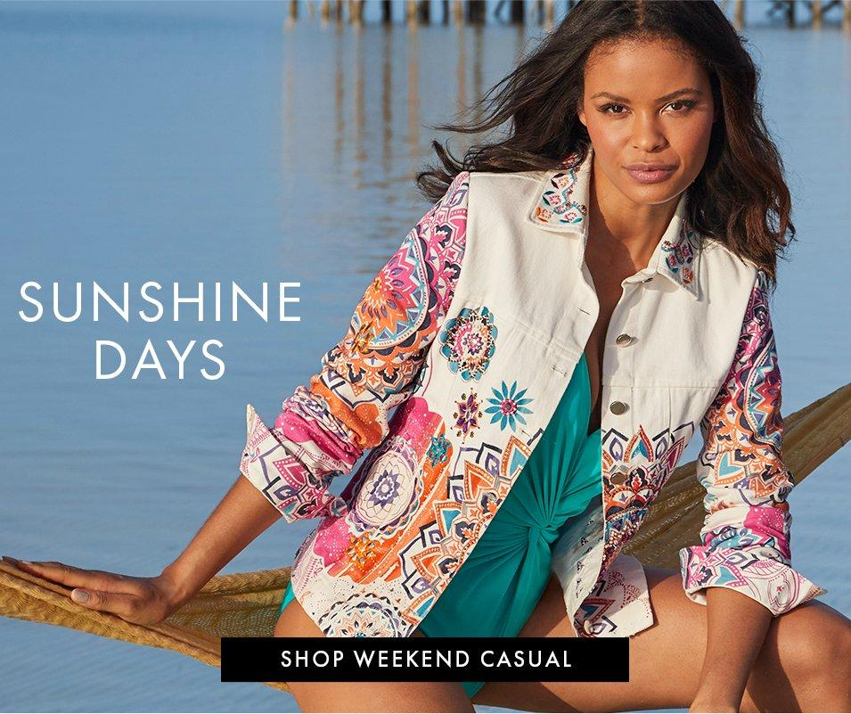 model wearing a white denim jacket with colorful embroidery and a teal one-piece swimsuit.