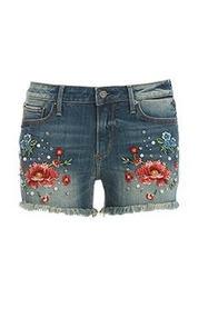 denim shorts with floral embroidery.