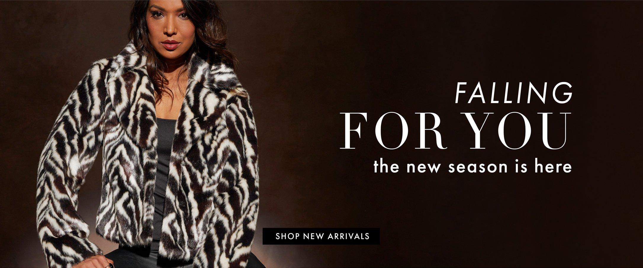 model wearing a white and brown zebra striped faux-fur jacket, black tank tops, and black pants. right text: falling for you. the new season is here. shop new arrivals.