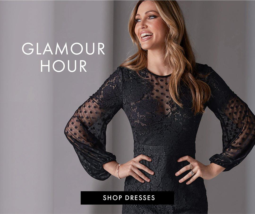 model wearing a black lace and swiss dot long-sleeve sheath dress. left text: glamour hour. shop dresses.