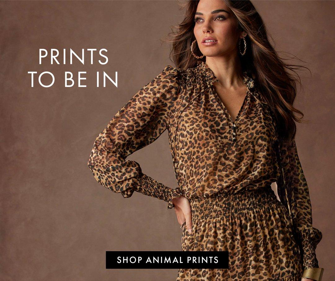 model wearing a leopard print long-sleeve smocked dress and hold hoop earrings. left text: prints to be in. shop animal prints.