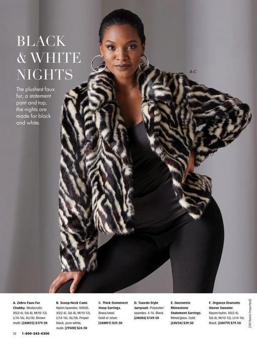 model wearing a zebra faux-fur chubby, black scoop-neck cami, black leggings, and silver hoop earrings.