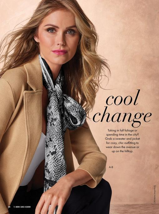 model wearing a tan sweater blazer, white tank top, snakeskin scarf, and jeans.