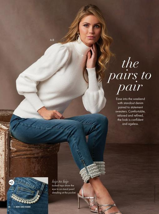 model wearing a white puff-sleeve turtleneck sweater, white hoop earrings, pearl embellished ankle jeans, and silver strappy heels.