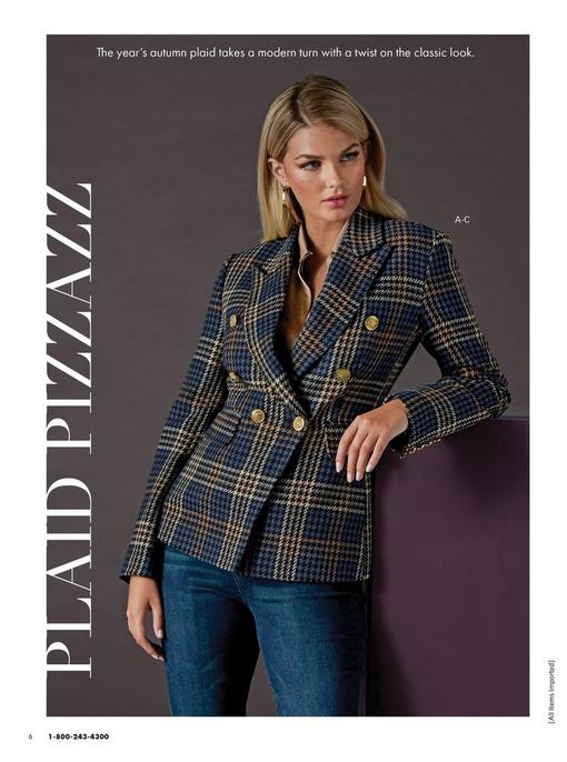 model wearing a navy plaid double-breasted blazer, tan button-up charm blouse, gold hoop earrings, and jeans.