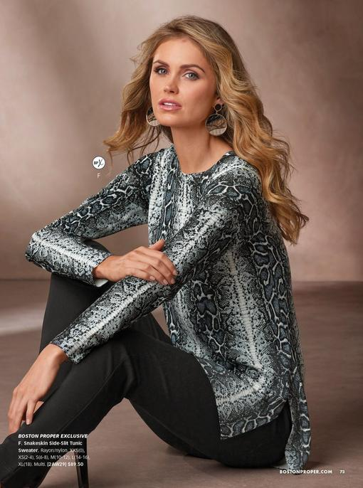 model wearing a snakeskin print gray long sleeve tunic top and black jeans.