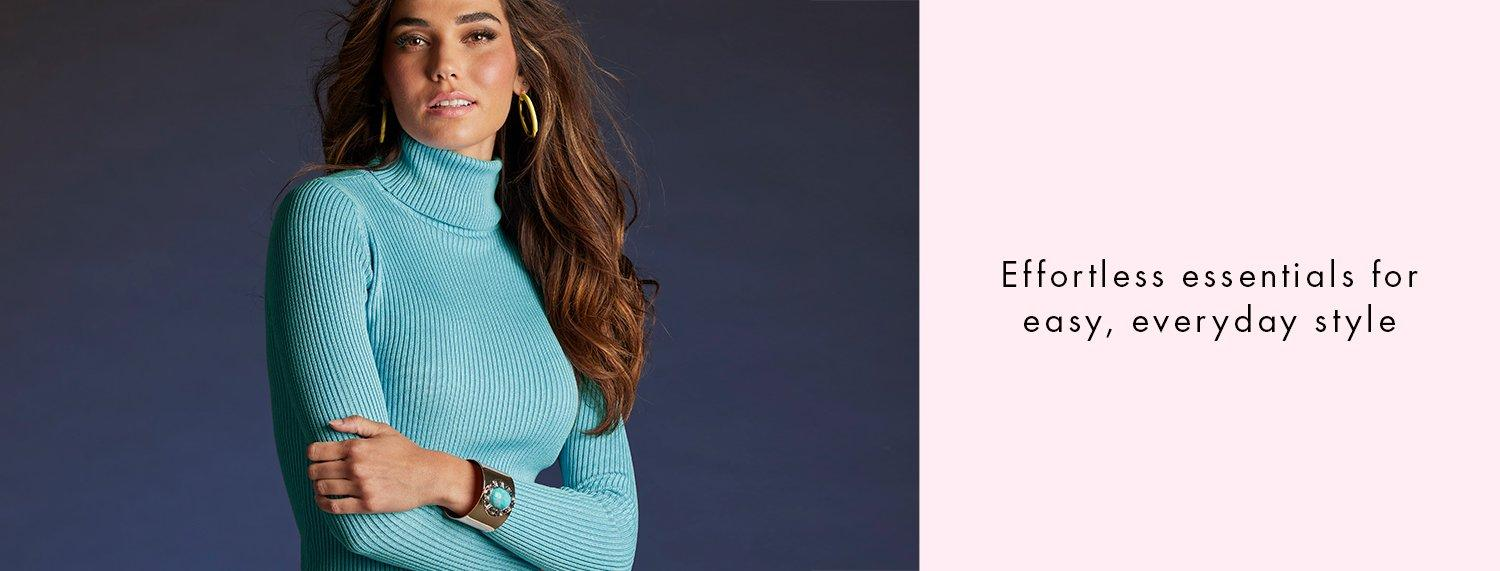 model wearing a light blue ribbed turtleneck sweater and gold earrings. right panel has black text on pink background: effortless essentials for easy, everyday style.