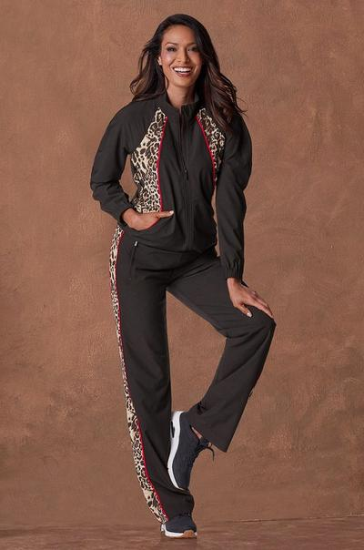 model wearing a black and leopard print sport warm-up and black sneakers.