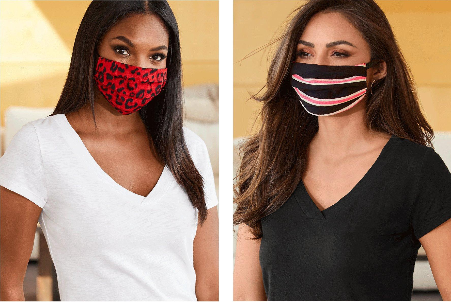 left model wearing a red and black leopard print face mask and white v-neck tee. right model wearing a pink, black, and white striped face mask with a black v-neck tee.