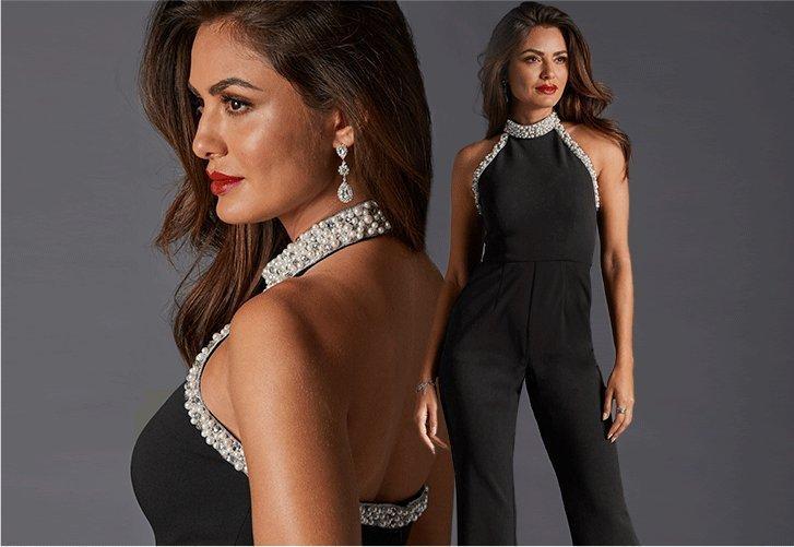 model wearing a pearl embellished high-neck black jumpsuit.