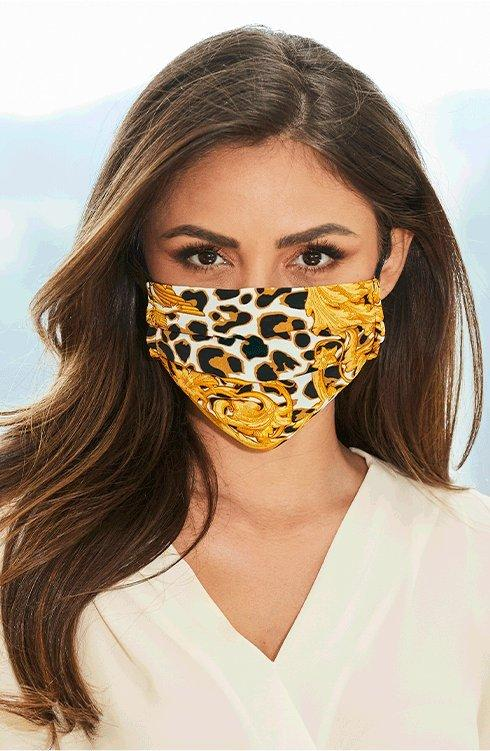 model wearing a leopard and chain print face mask.