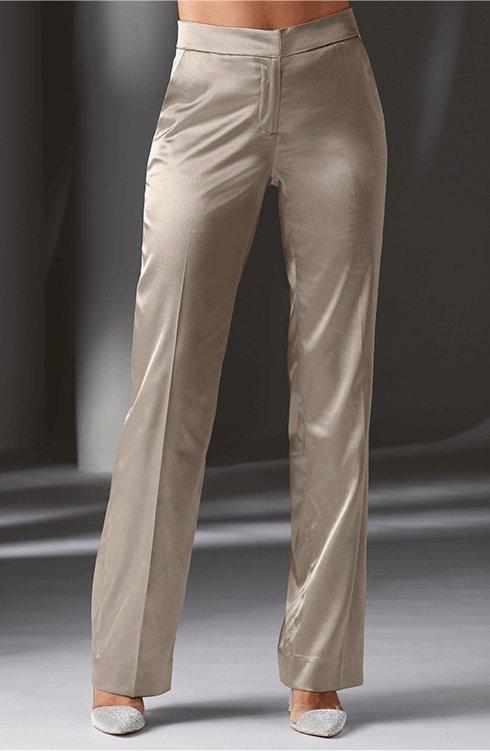 model wearing beige satin trousers.