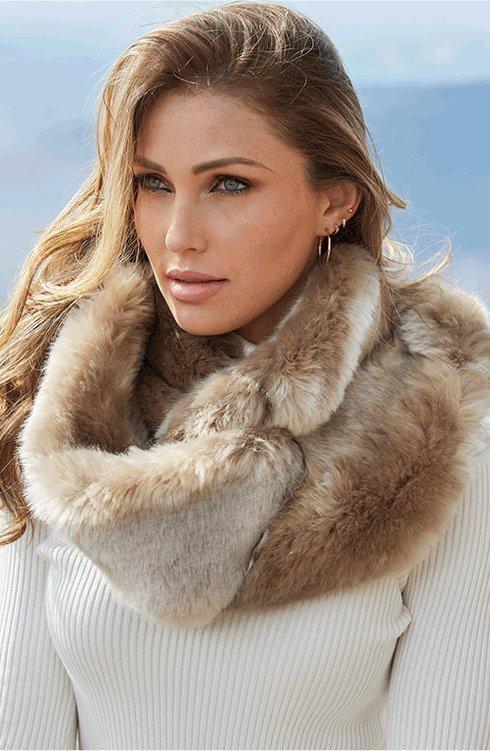 model wearing a tan faux-fur infinity scarf.