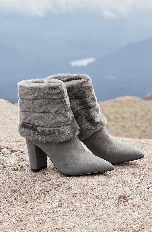 gray faux fur cuffed heeled booties.